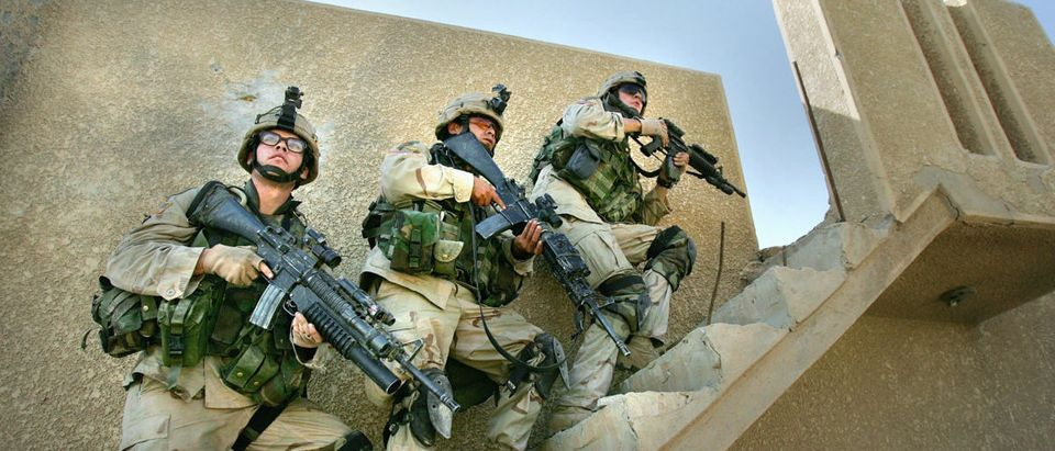 FALLUJAH, IRAQ - NOVEMBER 10: U.S. Army soldiers from the 1st Infantry Division's 2nd Battalion-2nd Regiment clear abandoned houses of insurgent fighters November 10, 2004 during fighting in the Iraqi insurgent stronghold of Fallujah. On the authority of Iraqi President Ayed Allawi, U.S and Iraqi forces are currently engaged in a battle to take back control of the city ahead of planned nationwide elections in January. (Photo by Scott Nelson/Getty Images)