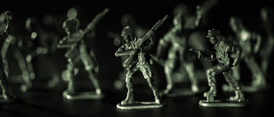 A group of green plastic toy soldiers, Concept idea of World War 2. (Media credit Nixx Photography/Shutterstock)