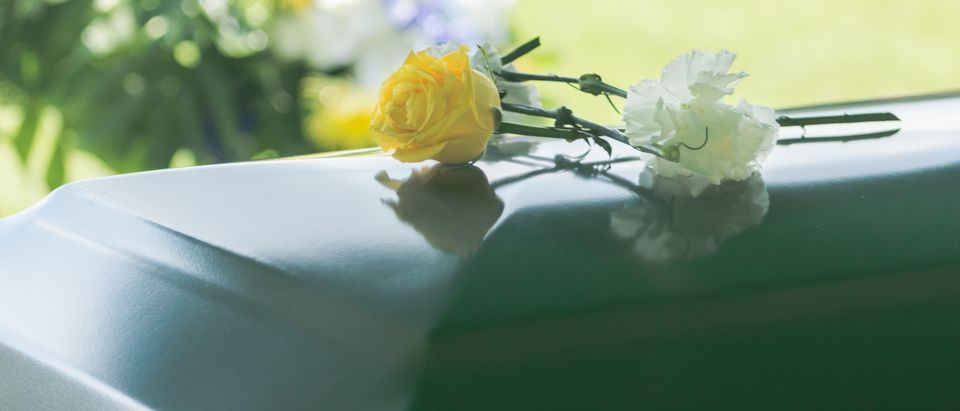 Casket with flower on top