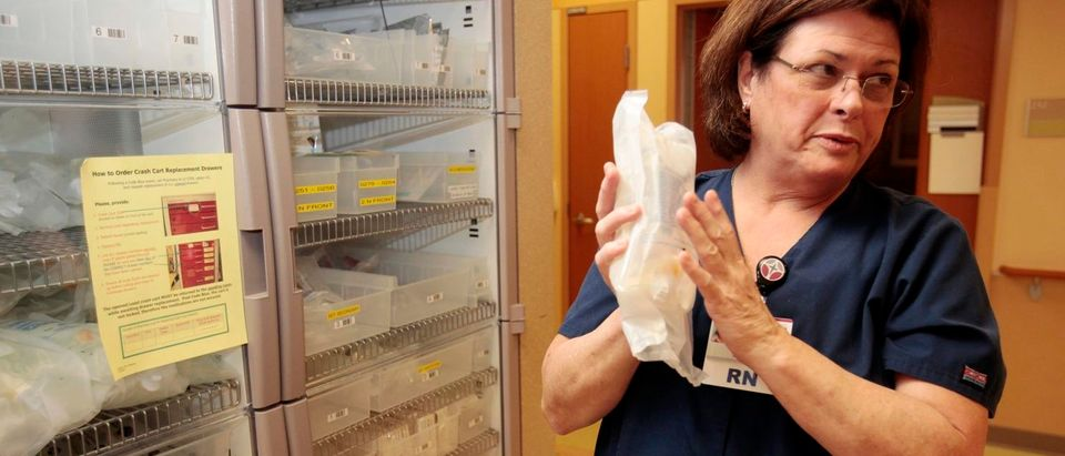 Nurse Susan Krussell RN shows saline bags she uses when administering medication to patients with Fungal Meningitis due to contaminated steroid infections, at St. Joseph Mercy Ann Arbor hospital in Ypsilanti, Michigan December 21, 2012. St. Joseph Mercy -- a 537-bed Catholic hospital located on the doorstep of the University of Michigan -- has played an outsized role in the fight against one of the largest fungal meningitis outbreaks in US history, treating 169 of the state's 223 cases, including 7 people who died. REUTERS/Rebecca Cook
