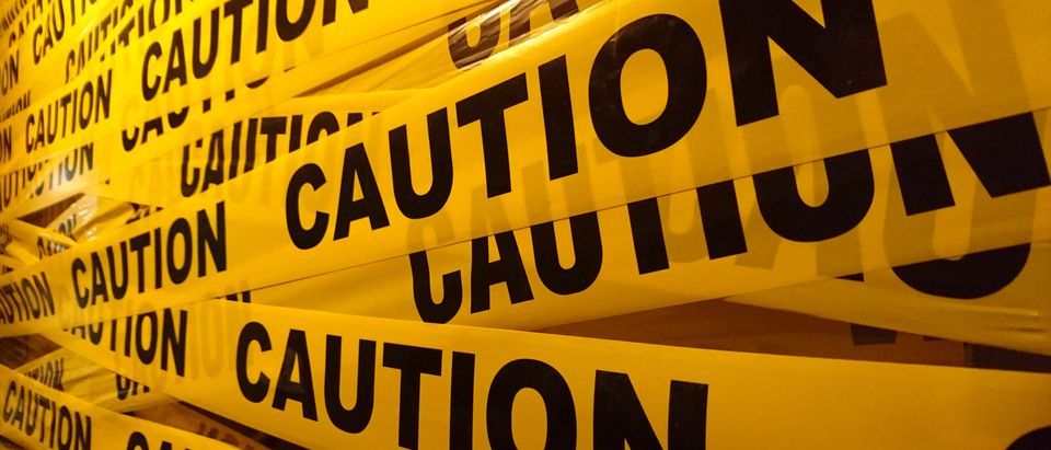 Caution tape (Shutterstock/T.Chaleomphon)