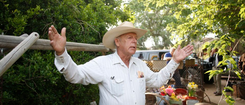 Rancher Cliven Bundy gestures at his home in Bunkerville