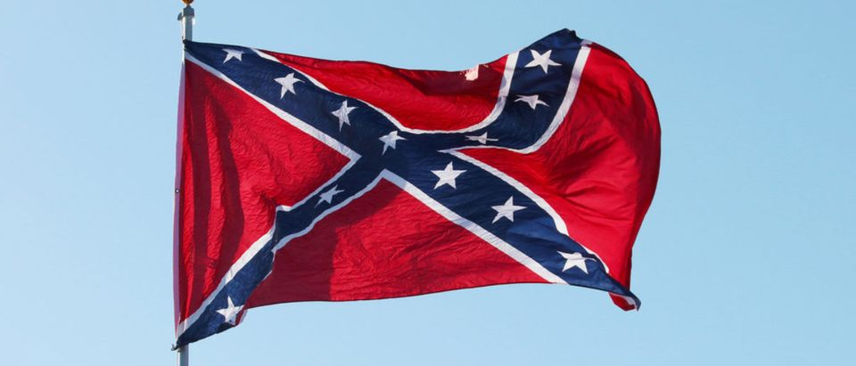 A Confederate rebel flag waves in the wind. (Shutterstock/MarynaG)