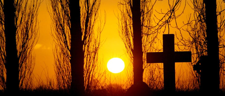 The sun sets over St Peter's Church graveyard in Swepstone, Leicestershire, in the east Midlands, February 20, 2004.