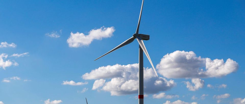 Power-generating wind turbines are seen near the city of Waremme