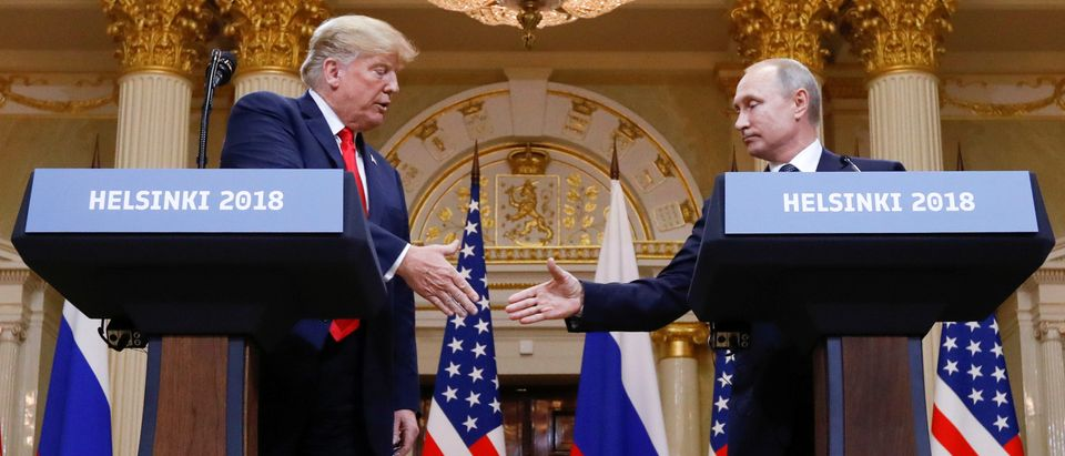 U.S. President Donald Trump and Russia's President Vladimir Putin shake hands during a joint news conference after their meeting in Helsinki, Finland, July 16, 2018. REUTERS/Kevin Lamarque