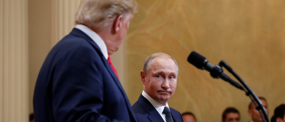 U.S. President Donald Trump and Russia's President Vladimir Putin hold a joint news conference after their meeting in Helsinki, Finland, July 16, 2018. REUTERS/Kevin Lamarque