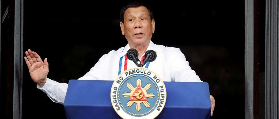 FILE PHOTO: Philippine's President Rodrigo Duterte speaks during the 120th Philippine Independence day celebration at the Emilio Aguinaldo shrine in Kawit, Cavite Philippines June 12, 2018. REUTERS/Erik De Castro/File Photo