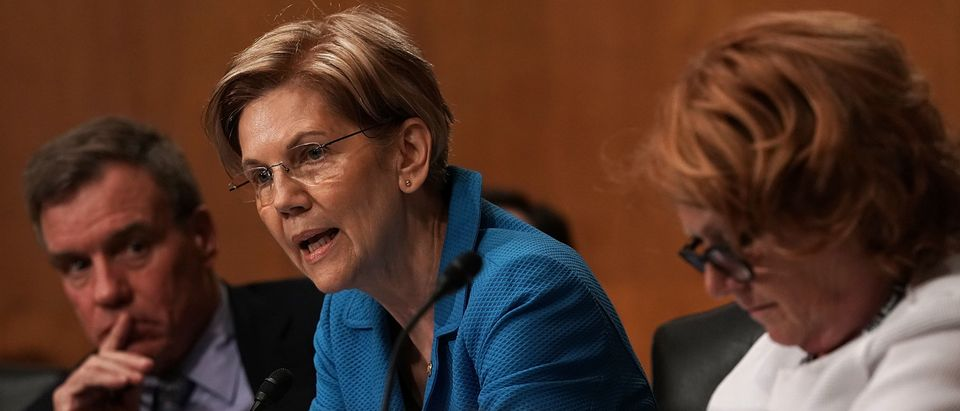 WASHINGTON, DC - JULY 19: U.S. Sen. Elizabeth Warren (D-MA) (2nd L) speaks as Sen. Mark Warner (D-VA) (L) listens during a confirmation hearing before the Senate Committee on Banking, Housing, and Urban Affairs July 19, 2018 on Capitol Hill in Washington, DC. Reed will become the president of the Export-Import Bank of the United States if confirmed by the Senate. (Photo by Alex Wong/Getty Images)
