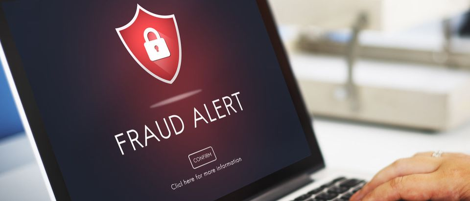 Fraud alert on a laptop computer.