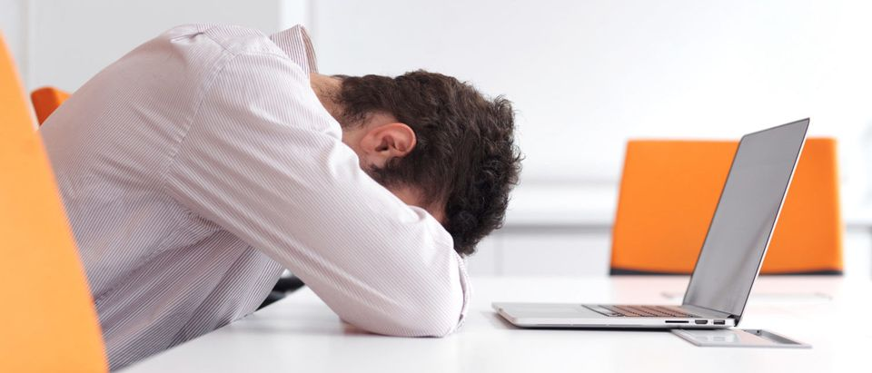 A man is frustrated with his computer and the websites he is visiting. [Shutterstock - ESB Professional]