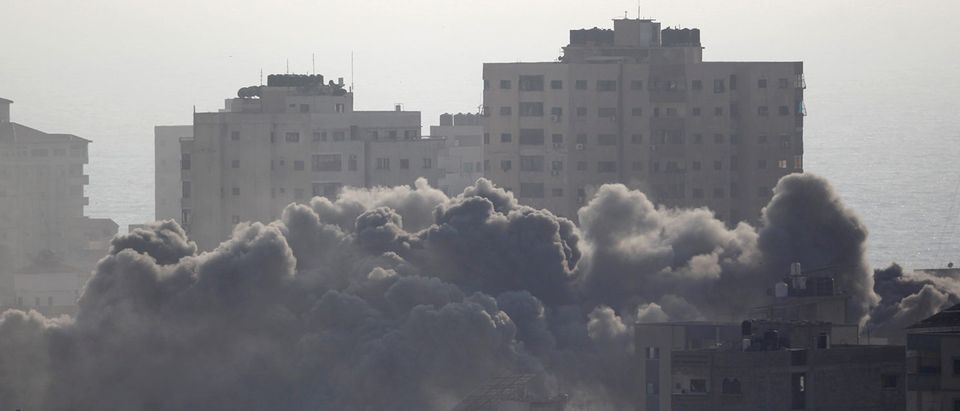 Smoke rises following an Israeli strike on a building in Gaza City