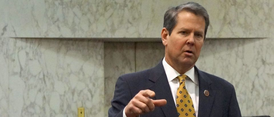 """FILE PHOTO: Georgia Secretary of State Brian Kemp speaks with visitors to the state capitol about the """"SEC primary"""" involving a group of southern states voting next month in Atlanta, Georgia, U.S., February 24, 2016. REUTERS/Letitia Stein"""