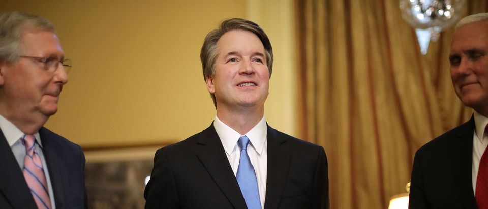 WASHINGTON, DC - JULY 10: Judge Brett Kavanaugh (C) poses for photographs with Vice President Mike Pence (R) and Senate Majority Leader Mitch McConnell (R-KY) before a meeting in McConnell's office in the U.S. Capitol July 10, 2018 in Washington, DC. U.S. President Donald Trump nominated Kavanaugh to succeed retiring Supreme Court Associate Justice Anthony Kennedy. (Photo by Chip Somodevilla/Getty Images)