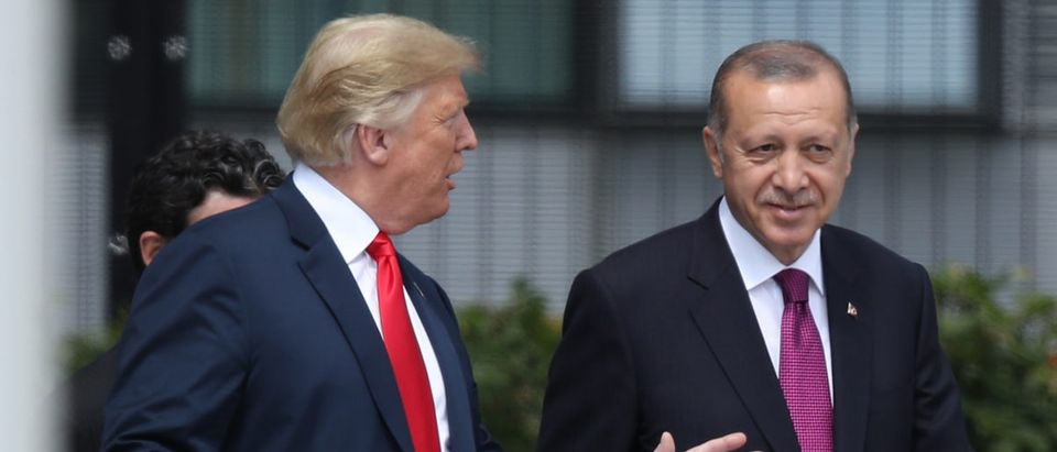 President Donald Trump (L) and Turkish President Recep Tayyip Erdogan attend the opening ceremony at the 2018 NATO Summit at NATO headquarters on July 11, 2018 in Brussels, Belgium. Leaders from NATO member and partner states are meeting for a two-day summit, which is being overshadowed by strong demands by U.S. President Trump for most NATO member countries to spend more on defense. (Photo by Sean Gallup/Getty Images)