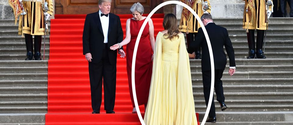 (L-R) US President Donald Trump, Britain's Prime Minister Theresa May, US First Lady Melania Trump and Philip May take their positions on the steps in the Great Court to watch the bands of the Scots, Irish and Welsh Guards perform a ceremonial welcome as they arrive for a black-tie dinner with business leaders at Blenheim Palace, west of London, on July 12, 2018, on the first day of President Trump's visit to the UK. - The four-day trip, which will include talks with Prime Minister Theresa May, tea with Queen Elizabeth II and a private weekend in Scotland, is set to be greeted by a leftist-organised mass protest in London on Friday. (Photo by Ben STANSALL / POOL / AFP) (Photo credit should read BEN STANSALL/AFP/Getty Images)
