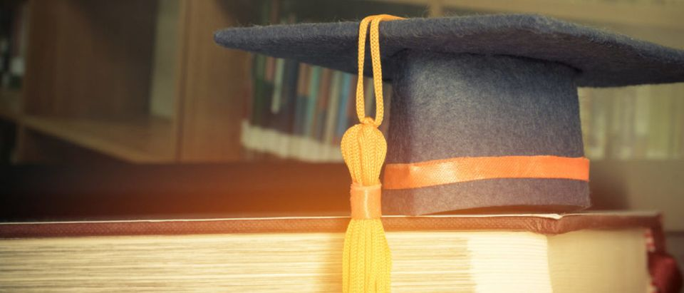 Featured is a cap typically worn at graduation. (Shutterstock/smolaw)