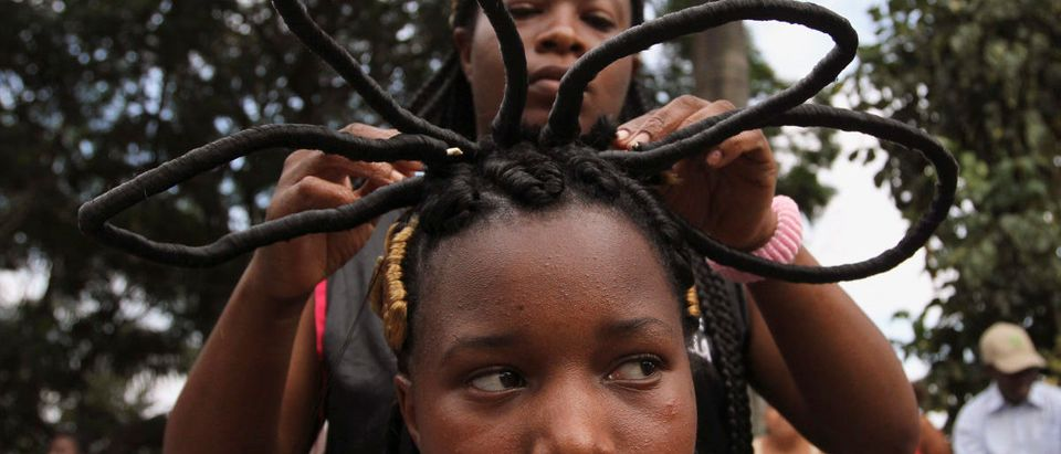 A woman gets an African-Colombian hairstyle during the Afro-hairstyles VIII Competition in Cali