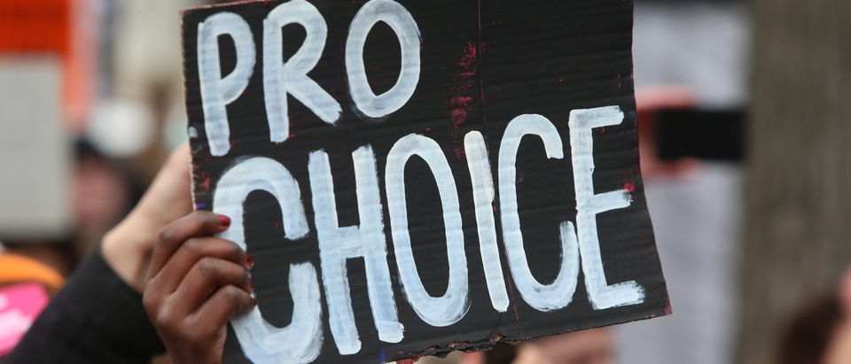 Hand holding pro-choice sign