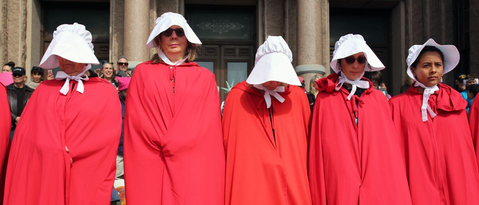 Handmaids Tale outfits (Shutterstock/Vic Hinterlang)