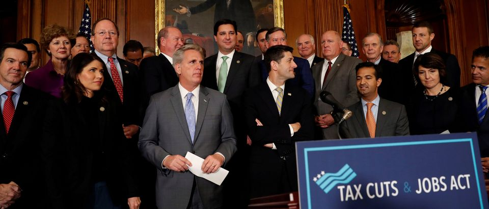 """FILE PHOTO: U.S. House Republicans, including Speaker of the House Paul Ryan and House Majority Leader Kevin McCarthy, celebrate at a news conference announcing the passage of the """"Tax Cuts and Jobs Act"""" at the U.S. Capitol in Washington, DC, U.S., November 16, 2017. REUTERS/Aaron P. Bernstein/File Photo"""