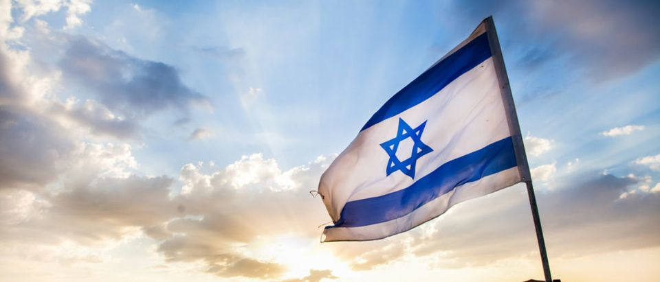 The Israeli flag flies in the wind. (Shutterstock/Dan Josephson)