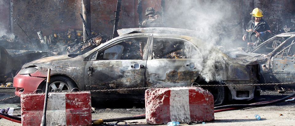 Afghan officials inspect the site of a blast in Jalalabad city
