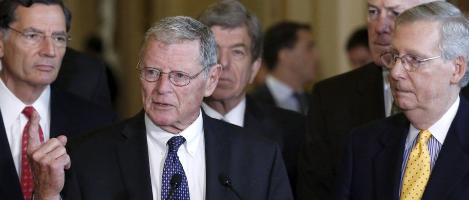 U.S. Senator James Inhofe (R-OK) (2nd L) joins Majority Leader Mitch McConnell (R-KY) (R) and other Republican leaders to address federal highway funding legislation, during a news conference following the weekly Republican caucus policy luncheon at the U.S. Capitol Hill in Washington July 21, 2015. REUTERS/Jonathan Ernst