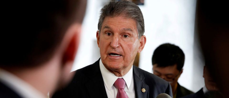 Senator Joe Manchin (D-WV) speaks to the media as he arrives for a Senate Intelligence Committee hearing evaluating Russian interference in U.S. elections