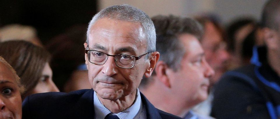 FILE PHOTO: Podesta and Flournoy attend Hillary Clinton's address to her staff and supporters about the results of the U.S. election at a hotel in New York