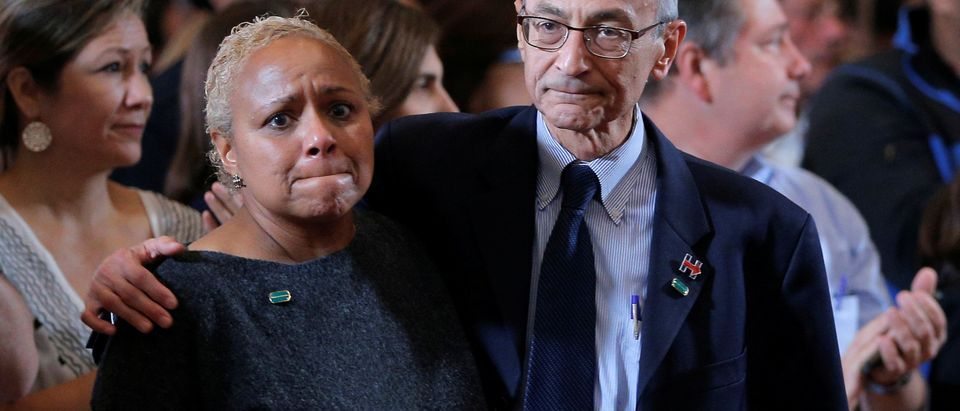 Campaign Chairman John Podesta hugs Tina Flournoy, chief of staff to former U.S. President Bill Clinton, as they attend an event being held by Hillary Clinton to address her staff and supporters about the results of the U.S. election at a hotel in the Manhattan borough of New York, U.S., Nov. 9, 2016. REUTERS/Brian Snyder/File Photo
