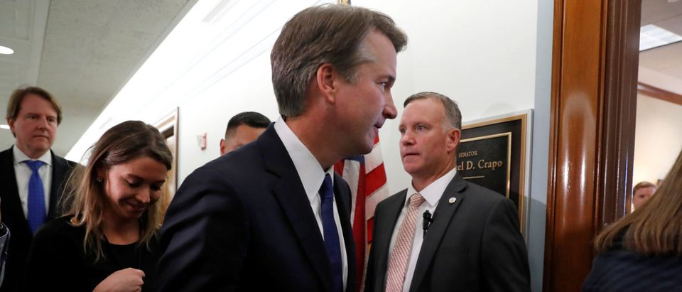 Supreme Court Justice nominee Brett Kavanaugh walks to a meeting with Sen. Michael Crapo (R-ID) at his office in the Dirksen Senate Office Building in Washington