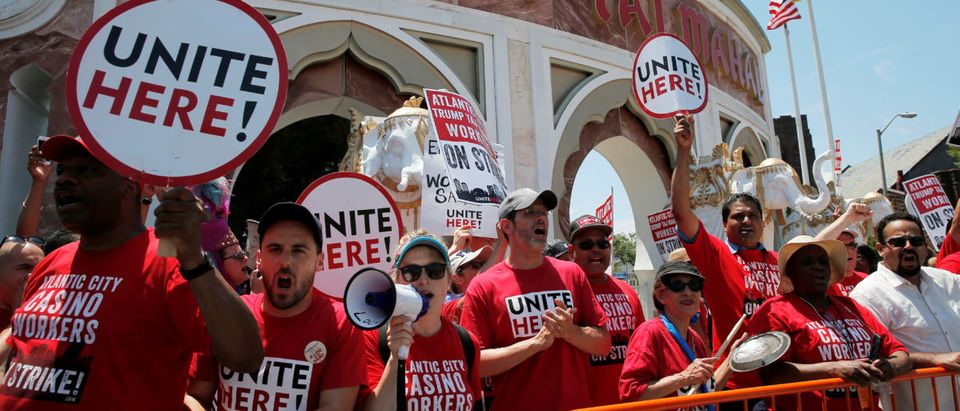Striking union workers from local 54 cheer after U.S. Democratic presidential candidate Hillary Clinton stopped to greet them outside the Trump Taj Mahal in Atlantic City