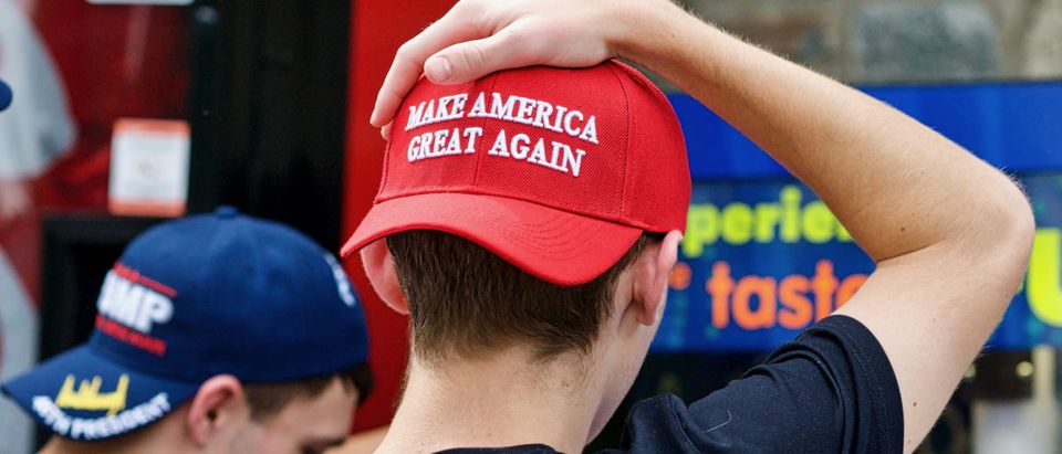 Washington, DC - October 6, 2017: Two unidentified men display their support for President Donald J. Trump through the hats they are wearing during a visit to the National Zoo. [Shutterstock/John M. Chase]