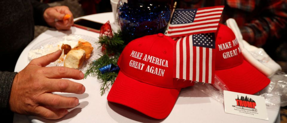 """""""Make America Great Again"""" hats lie on a table at Republican U.S. Senate candidate Roy Moore's election night party in Montgomery, Alabama, U.S. December 12, 2017. (REUTERS/Carlo Allegri)"""