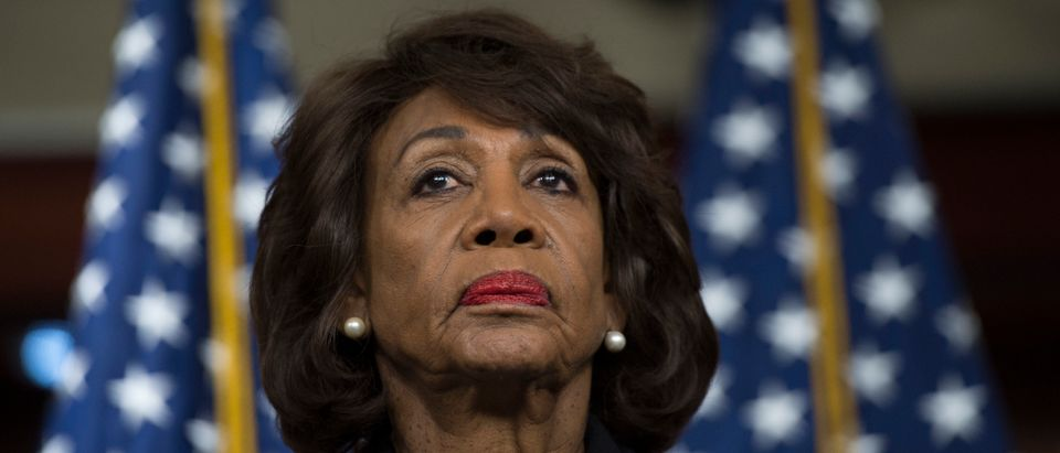 US Representative Maxine Waters (D-CA) looks on before speaking to reports regarding the Russia investigation on Capitol Hill in Washington, DC on January 9, 2018. (Photo credit ANDREW CABALLERO-REYNOLDS/AFP/Getty Images)