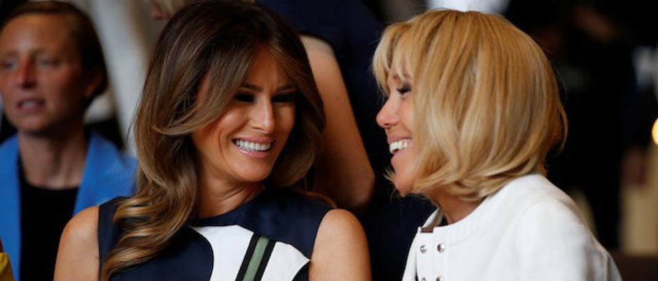 U.S. first lady Melania Trump and France's first lady Brigitte Macron attend a concert at the Queen Elisabeth Music Chapel in Waterloo