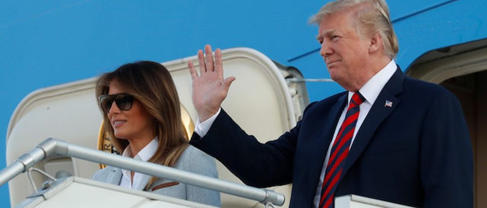 U.S. President Donald Trump and first lady Melania Trump wave as they arrive at Helsinki-Vantaa airport in Vantaa