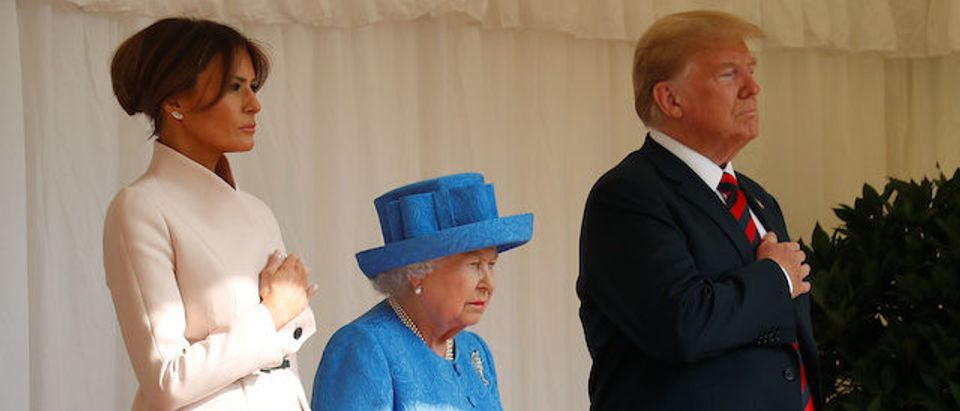 U.S. President Donald Trump and the First Lady Melania Trump listen to the Coldstream Guards, play the U.S. national anthem, with Britain's Queen Elizabeth, during a visit to Windsor Castle in Windsor