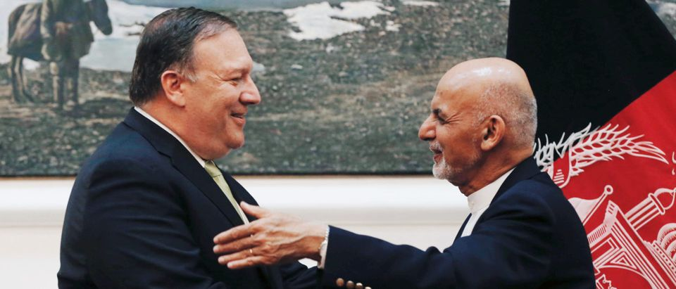 Afghan President Ashraf Ghani, and U.S. Secretary of State Mike Pompeo, shake hands during a news conference in Kabul, Afghanistan