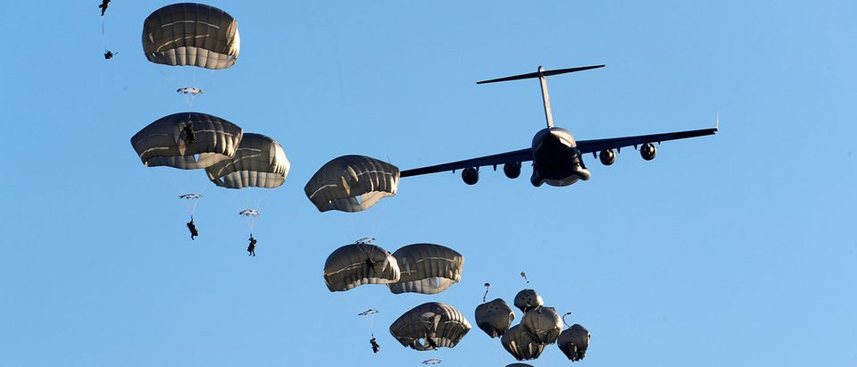 U.S. Army paratroopers leave C-17 aircraft to land during NATO exercise Swift Response 2018 on Adazi military ground