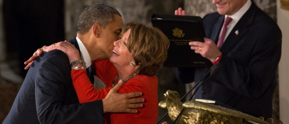 WASHINGTON, D.C. -- JANUARY 21: U.S. President Barack Obama embraces Speaker of the House Nancy Pelosi at the Inaugural Luncheon in Statuary Hall on inauguration day at the U.S. Capitol building January 21, 2013 in Washington D.C. President Obama was ceremonially sworn in for his second term today. (Photo by Allison Shelley/Getty Images)