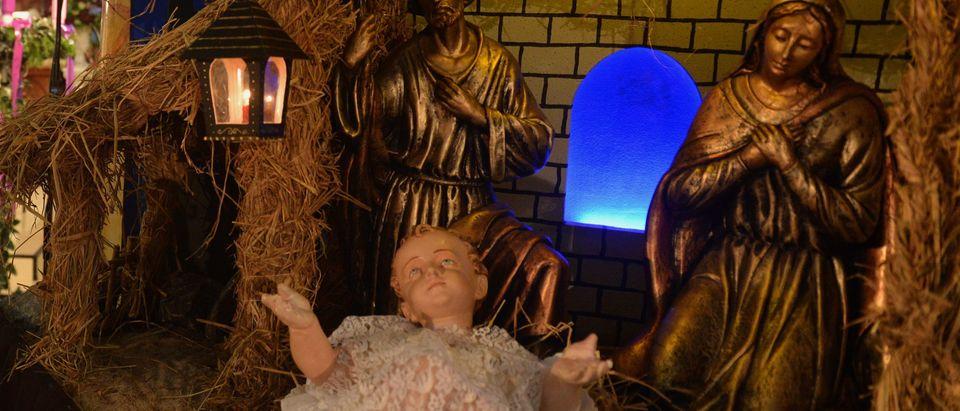 The nativity scene is displayed during Christmas mass in Colombo on December 25, 2017. Christians account for some six percent of Sri Lanka's 21 million people. / AFP PHOTO / ISHARA S. KODIKARA (Photo credit should read ISHARA S. KODIKARA/AFP/Getty Images)