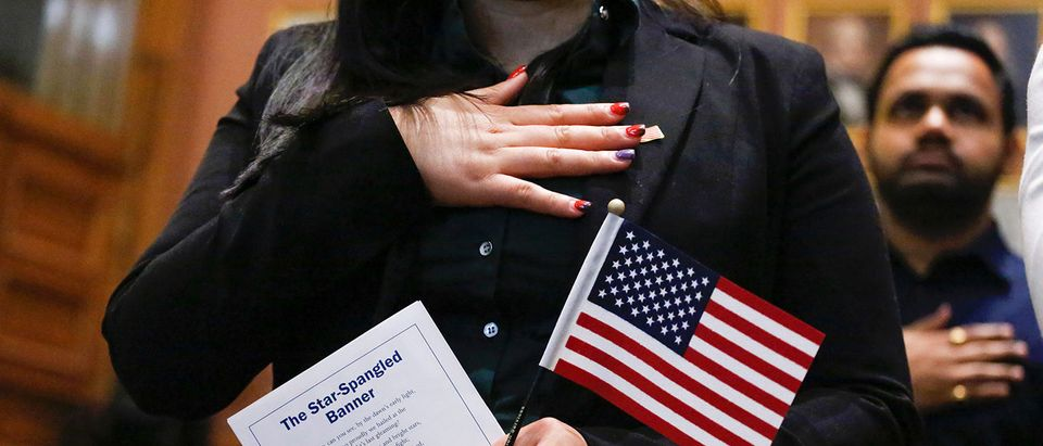 Candidates for US citizenship take the oath of allegiance during a Naturalization Ceremony for new US citizens at the City Hall of Jersey City in New Jersey on February 22, 2017. KENA BETANCUR/AFP/Getty Images