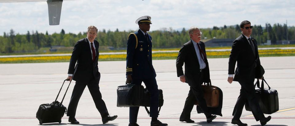 """U.S. military aide carries nuclear """"football"""" as President Donald Trump arrives to attend the G7 Summit in Quebec, Canada"""