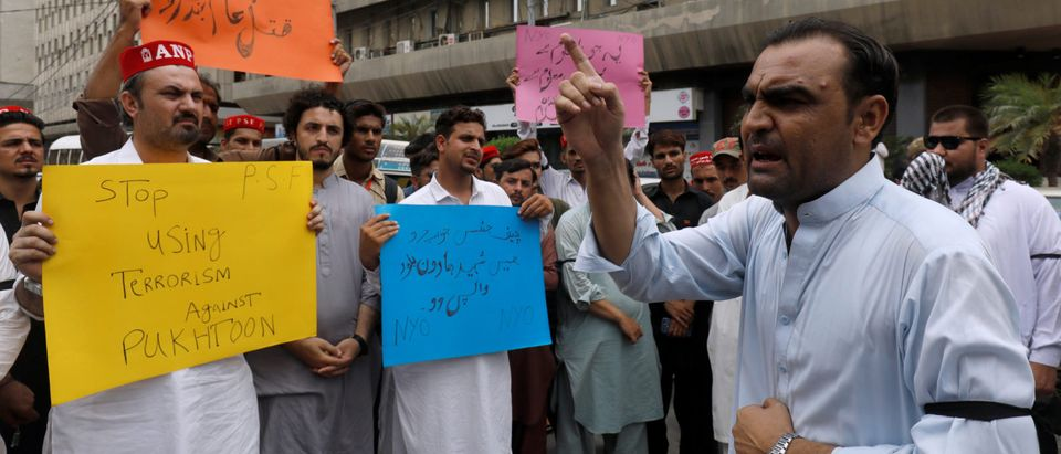 Activists of ANP hold signs as they chant slogans to condemn the Tuesday's suicide attack in Karachi