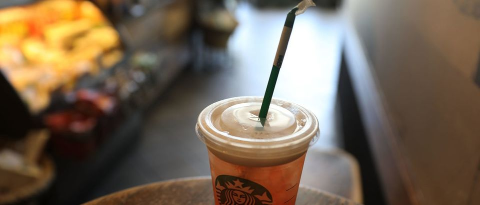 MIAMI, FL - JULY 09: A plastic straw is seen in a Starbucks drink on July 9, 2018 in Miami, Florida. Starbucks announced today that it plans on phasing out all plastic straws from its 28,000 stores worldwide by 2020. (Photo Illustration by Joe Raedle/Getty Images)