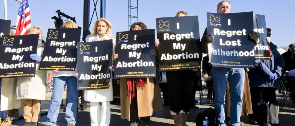 Pro-lifers holding sign
