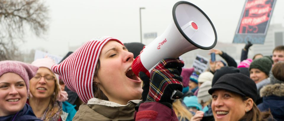 Activist yells at a protest. (Shutterstock/Ken Wolter)