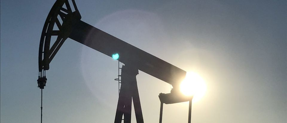 A pump jack is seen at sunset near Midland